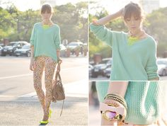 A citrus-hued pop on a necklace and heels goes a long way in brightening up printed jeans and a pastel sweater.