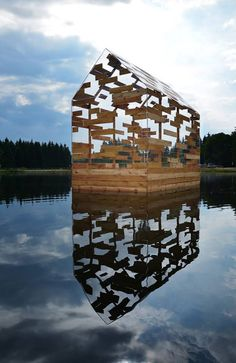 Walden Raft is a cabin offering seclusion in the middle of a French lake.This see-through floating hut designed by Elise Morin and Florent Albinet is modelled on the remote cabin built by American author Henry David Thoreau in the century (+ slideshow). Glass Cabin, Glass House, Pavillion, Wood Architecture, Floating Architecture, Memorial Architecture, Computer Architecture, Enterprise Architecture, Dezeen