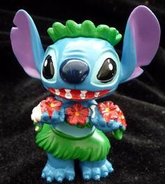 Image from http://guideimg.alibaba.com/images/shop/73/08/21/8/2-5-tall-stitch-hula-dancer-hibiscus-flower-lei-maker-in-hawaii-pvc-figurine-cupcake-cake-topper-table-decoration-disney-party-favor-in-lilo-and-stitch-movie_3295138.jpg.