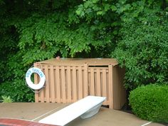 Pool Equipment Cover Ideas enclosure with walking stones pathway The Cute Enclosure Hides The Pool Equipment And Adds A Fun Touch With The Personalized Life