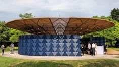 African architect Diébédo Francis Kéré has unveiled this year's Serpentine Pavilion, an indigo-blue structure with a latticed canopy and a waterfall to collect rainwater