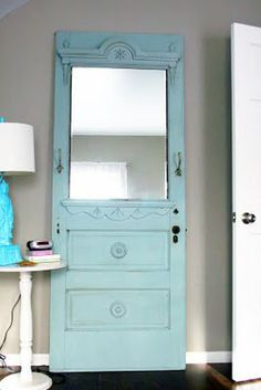 an old door turned into a mirror w/ hooks--love the idea and the color!