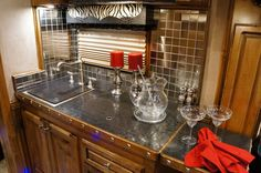This one-of-a-kind kitchen adds style and flair to this custom Outlaw Conversions living quarter!