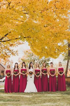 Beautiful Fall colors. Sara Byrne Photography, if I was to ever get married, I want strapless floor length cranberry bridesmaids dresses like these