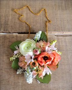 Spring flower necklace for a bridesmaid; grown and designed by Love 'n Fresh Flowers.