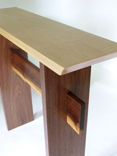 Loving the arch in the tiger maple wood grain of this Statement Hall Table top…