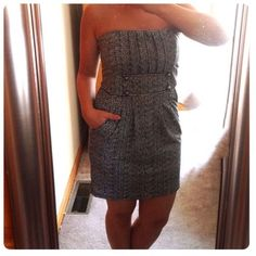 Black and White Strapless Button Dress This dress has never been worn. Cute black and white strapless dress with 4 button front. Has an empire waist and pockets on either size. It's a stretch material and goes on over your head, no zippers or buttons to close. Francesca's Collections Dresses
