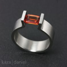 mandarin sapphire ~ tension-set in upright stainless prongs