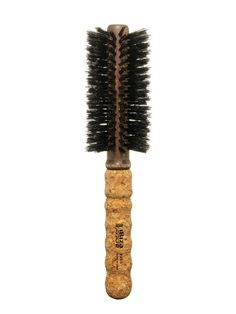 The Ibiza Hair Medium Round Brush gently grips hair to lift and add volume or smooth flyaways. We also love the no-slip cork handle.