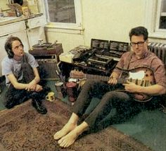 "Here's a photo of JL and me, JF, in my studio taken in 1990 I bet. Lots of personal details that come rushing back. The El Pico coffee can and the two espresso makers tell you where our coffee production was at. The Coral guitar was actually a tour purchase (not the one in the Don't Let's Start video which was borrowed) and of course the ""pro"" Marantz cassette record for the Dial-A-Song announcements and 2 answering machines (always breaking) + the big box of DAS cassettes. Still use the… Bands, Band Photos, Music Humor, Im Trying, Rock Music, Musicals, Two By Two, Told You So, Rock"