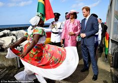 Prince Harry, accompanied by the Governor General Cecile la Grenade, was greeted by a local woman in a colourful skirt when he arrived at Grenada Cruise Port