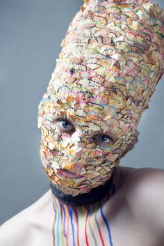 pencil shavings of various colors,  self-portrait by an artist under the moniker, Anmagdan.
