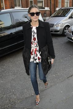 Olivia Palermo blossomed in a floral peplum top, red printed pumps, and a fur-trim coat.