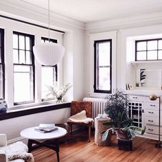 A GENIUS Small-Space Trick For Your Living Room #refinery29  http://www.refinery29.com/best-coffee-tables#slide-3  See that tree trunk behind the plant? It's the perfect size to go between two chairs. ...