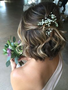 Short hair formal style half up half down created with volume tonic and hairspray