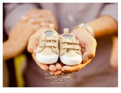 How cute Daddy is holding his baby's shoes....