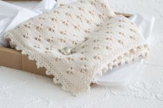 I am head over heels in love with this precious baby blanket. Pattern and instructions on how to make this knit baby blanket using the clover eyelet and crocheted cloverleaf border, with videos to provide further instructions to diy this sweet baby blanket. One of my all-time favorite knit projects.