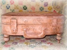 Make a suitcase into a footstool.  No instructions but would be pretty simple.