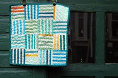 wonderful little quilt from knottygnome.  I love the colors, the patchwork, the quilting and how the photo was set up!