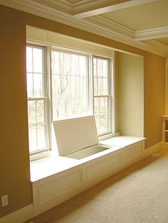 window seat storage. This is what I want to do in our master bedroom!