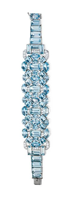 PLATINUM, AQUAMARINE AND DIAMOND BRACELET, CARTIER, LONDON, CIRCA 1930    The flexible strap decorated in a geometric pattern with emeraldcut, oval, squarecut and long hexagonalshaped aquamarines weighing approximately 60.50 carats, accented by round diamonds weighing approximately 2.90 carats, length 7 inches, signed Cartier, London, numbered 737 ?692.