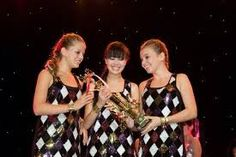 When Emma schcubet Jackie lee and Allie Henson win the 1st prize trophy of the nationals in Singapore