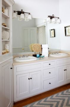 I love the cabinetry and the subtle beach theme. I like the angled cabinet. And of course I like the coastal accents.