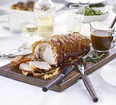 Sage and sausage meat are stuffed inside a pork loin to create a moist, flavoursome Sunday lunch main for a crowd
