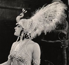 sydneyflapper:    girlmostlikely:    Gloria Swanson in a white peacock head dress, circa 1920s.     Swanson in the 1919 Cecil B Demille classic Male and Female