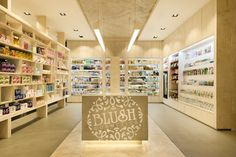 Blush Cosmetics flagship store by Mima Design Sydney Australia A basic shelving format with plenty of storage for extra stock was developed, integrating plenty of LED strip illumination for product display. Adjustable mirrors with edge lighting to reduce facial shadows on customers when testing make-up, as well as custom pendant lighting over the mid floor benches. A small treatment room at the back of the store introduces an additional beauty service