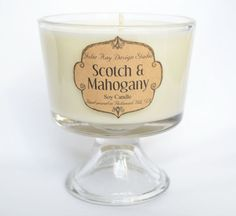 """SCOTCH & MAHOGANY soy candle is NEW for Spring 2015! This is a year round  candle that is a wonderful blend of butterscotch, maple, mahogany, and rich  tobacco. I would definitely define this as a high-end scent, its beautiful. The cute glass container adds a classic presentation to your kitchen  counter.  Burn Time:50 hours Size:3.75"""" dia. x 4.25"""" H 8 oz. candle  Each of my candles is made from 100% soy wax and hand poured in small  batches ensuring superior quality. I only use the…"""