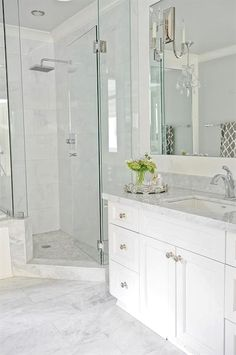 Really like the feel and colour of this bathroom Going for this look. Light grey floor tiles, white vanity, quartz countertop, white stacked wall tiles with accent tiles, and niche.Finial Kohler Faucet and showerhead. Grey Floor Tiles, Grey Flooring, Laminate Flooring, Marble Floor, Flooring Ideas, Marble Tile Bathroom, Bathroom Flooring, Bathroom Grey, Modern Bathrooms