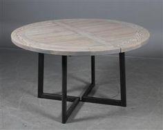 Vare: 4088640Dansk møbelproducent. Rundt spisebord med stålstel, plade i 40 mm massiv ask.