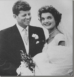 """Socialite Jacqueline Bouvier and then-U.S. Senator John F. Kennedy began dating soon after meeting at a dinner party organized by mutual friends in May of 1952. The couples engagement was officially announced on June 25,  1953. They were married on September 12, 1953, at St. Mary's Church in  Newport, Rhode Island by Boston's Archbishop Richard Cushing. There were  an estimated 700 guests in attendance and 1,200 attended the reception."