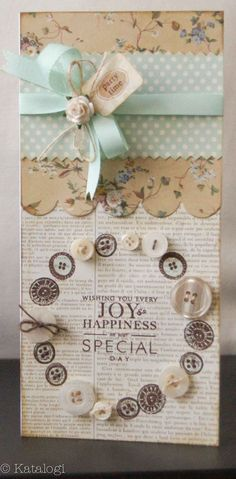 Joy and Happiness inside circle of buttons. Band of scalloped floral paper under ribbon