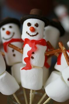 Marshmallow snowmen.  My nieces and I made these last year without sticks in them.  We also used a lot of red gel icing.  It looked like a snowman murder scene:)  Very tasty though!