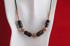Handcrafted Clear and Black Lampwork Beads with Copper Swirls and Copper Beads on Black Leather Cord......Handcrafted by Kaminski Jewelry Designs