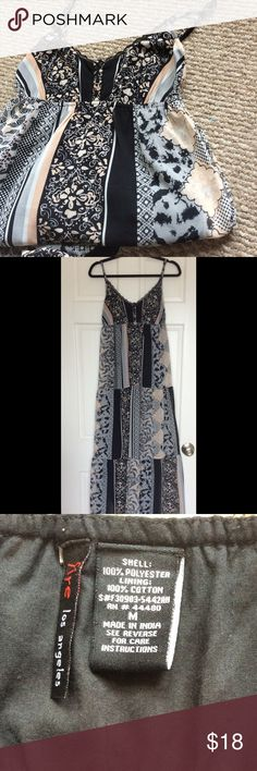 Floral dress  Beautiful black with floral print maxi dress, awesome condition, worn once. Adjustable straps. Fire Los Angeles Dresses Maxi