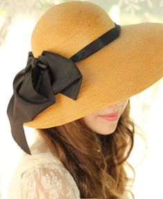 lovely yellow hat with black bow