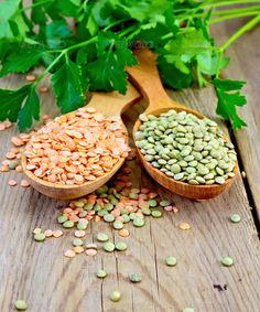 Lentils red and green in spoons with parsley on board ...  background, bean, board, cereal, close-up, color, condiment, corn, crop, dried, dry, eating, food, green, group, healthy, heap, indoors, ingredient, legume, lentil, life, nature, nobody, orange, organic, parsley, pea, plant, pour, raw, red, seasoning, seed, spoon, still, strew, utensil, vegetable, vegetarian, vertical, wooden