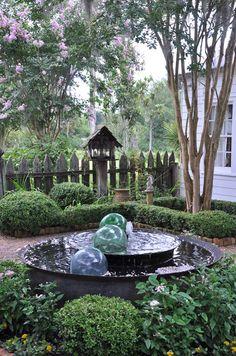 weathered fence statuary crepe myrtle sugar kettle fountain A. Dream Garden, Garden Art, Garden Design, Garden Ideas, Garden Fountains, Water Fountains, Outdoor Fountains, Garden Ponds, Koi Ponds