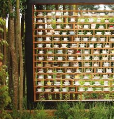 whimsical teacup wall from international garden festival in chaumont-sur-loire.