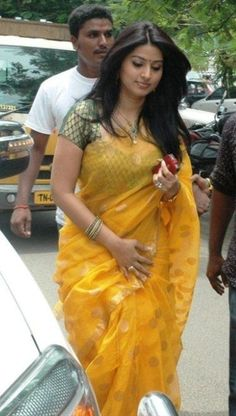 Sneha in Yellow Net Saree - MinMit Clothing