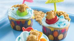 Here's a fun way to end your day at the beach! Kids can help arrange teddy bear-shaped graham snacks on top of frosted cupcakes.