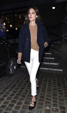 Photo via: Popsugar Alexa Chung breaks out her pristine white jeans for spring and cleanly pairs them with a navy coat, camel knit and strappy buckled flats. Super simple and super stylish! Keeping ea