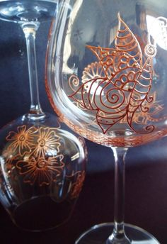 Bridal party gift. Wedding glassware-one of a kind wine glasses. Personalized (option)  Hand painted with symbolism in Henna style designs. Gold, copper or Pewter. Mehndi Glass, via Etsy.