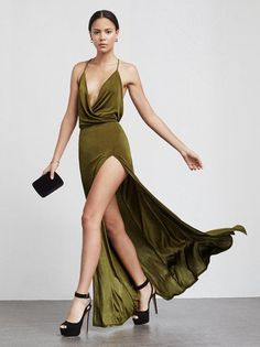 This is part of the Reformation x 4th and Bleeker NYE collection. The Martini Dress is a slinky, stretch matte jersey maxi dress with a plunging neckline, high slit, open back with criss cross straps. https://www.thereformation.com/products/martini-dress-castelvetrano?utm_source=pinterest&utm_medium=organic&utm_campaign=PinterestOwnedPins