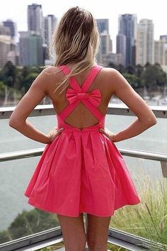 Pink bow. Open back. Mini-dress.