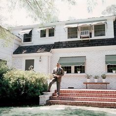 Clark Gable in front of his Encino ranch home, 1957.