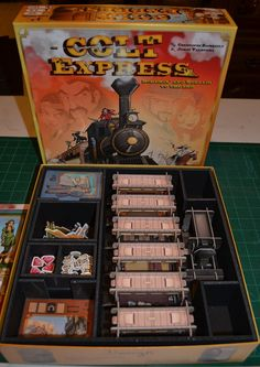 A foamcore insert to hold all the Colt Express cards and components. Designed to hold all the game cards in sleeves and made to have convenient removal trays to make set-up and tear-down easier. Robert Searing, designer and creator of Insert Here's foamcore inserts has a gift for creating skillful designs to accommodate games of abundant pieces, sleeved cards* and expansions* to fit in their original box. The hand-made craftsmanship of these inserts are impeccable! Professional looking ...